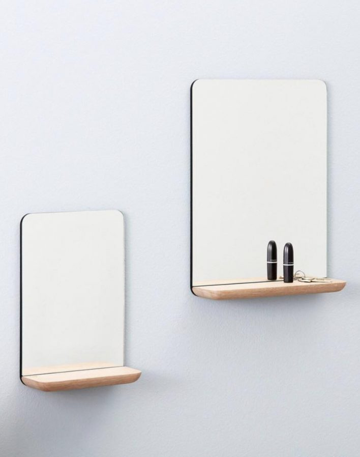 A wall mirror by Andersen Furniture Design Louise Siig